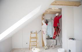 interior painting contractors painting a house in Miami, FL