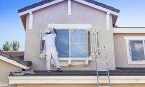 painter painting the exterior of house in miami